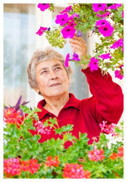 senior woman watching flowers