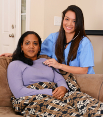 caregiver checking health of the woman